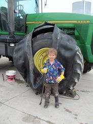 boy in front of tractor